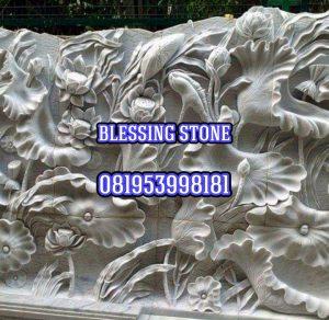 Relief batu paras bunga